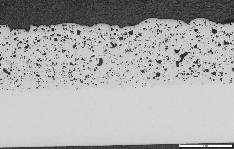 Przekrój próbki wydrukowanej wtechnologii SLM zproszku Fe48Mo14Cr15Y2C15B6