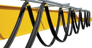 Systemy zasilań odbiorników ruchomych dla urządzeń dźwigowych